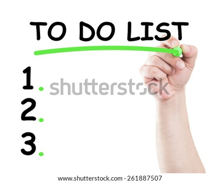 To do list concept made by a human hand holding a marker on transparent wipe board - stock photo