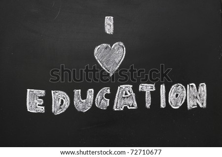 To express their love of education on the blackboard. - stock photo