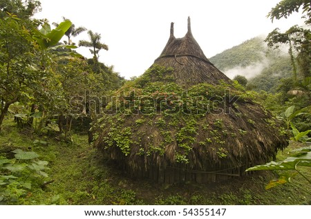 To get to Ciudad Perdida (The Lost City) in Colombia you must trek through the jungle for 6-days. This is an example of the type of structures found here. - stock photo
