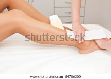 To the girl do epilation in salon close up - stock photo