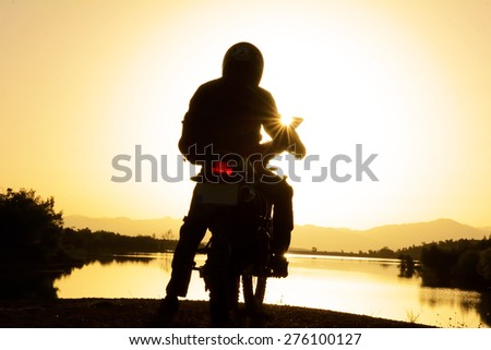 To watch the sunrise with motorcycle - stock photo