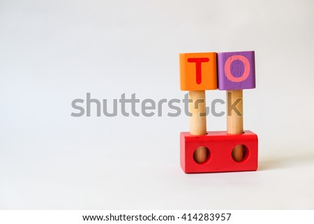 TO word written on wood blocks, white background with copyspace - stock photo