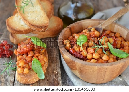 toast bread with chickpeas and tomatoes - stock photo