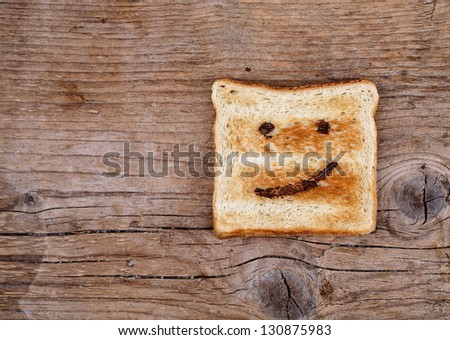 Toast Bread with happy face painted with hazelnut chocolate spread - stock photo