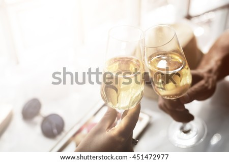 Toast Cheers Alcohol Beverage Celebration Party Concept - stock photo