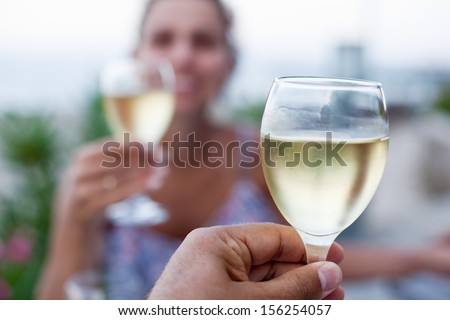 Toast for two to the sea during dinner. - stock photo