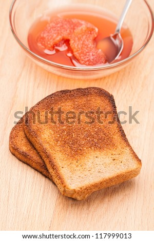 toast from bread with fruit jam and spoon - stock photo