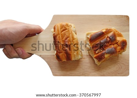 Toast on a wooden tray. - stock photo