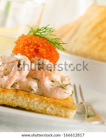 Toast skagen - shrimp and caviar on toast. Classic swedish appetizer - stock photo