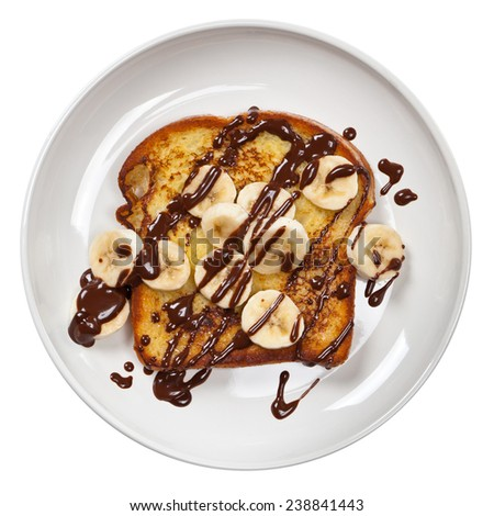Toast with Bananas and Chocolate sauce. Isolated on white. Selective focus. - stock photo
