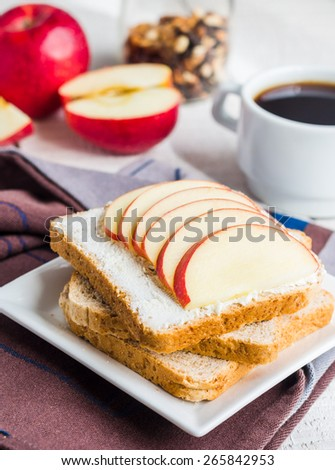 toast with cheese curd, honey and apple, a cup of coffee, a healthy breakfast - stock photo