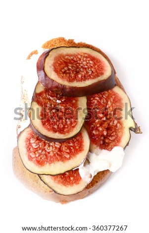 toast with figs and cream cheese on a white background - stock photo