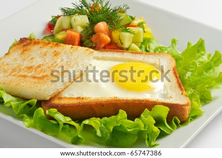 Toast with fried egg - stock photo