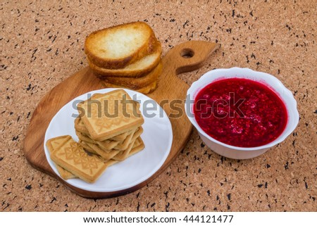 Toast with raspberry jam on a wood background - stock photo