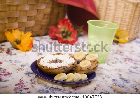 Toasted Blueberry Bagel with Sliced Bananas and Cream Cheese - stock photo