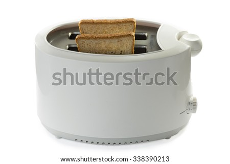 Toasted bread and toaster  - stock photo