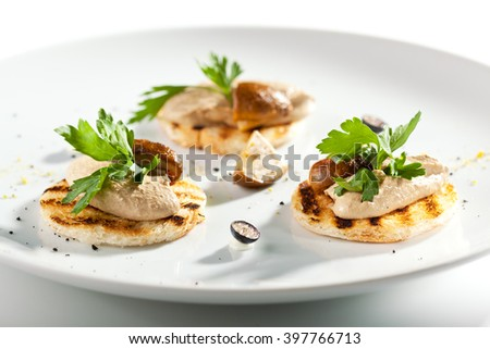 Toasted Bread with Chicken Liver Pate and Mushroom - stock photo