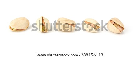 Toasted pistachios closeup on white background - stock photo