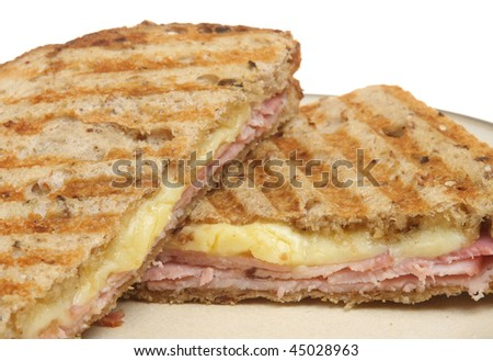 Toasted pressed sandwich or panini with ham and cheese. - stock photo