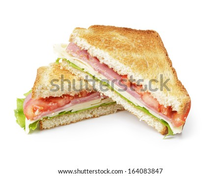 toasted sandwich with ham, cheese and vegetables, isolated - stock photo