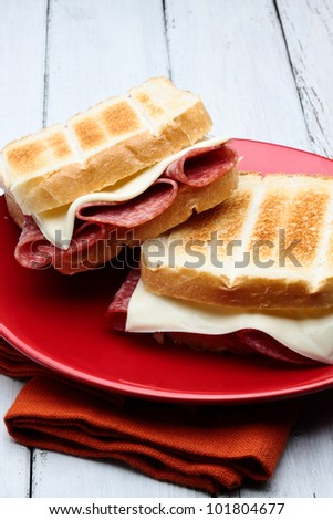 toasted white bread with salami and cheese - stock photo