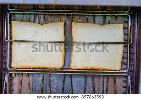 Toaster with bread slices close up photo - stock photo