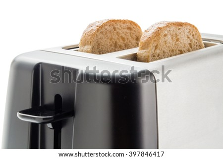 Toaster with bread slices. Electric toaster with two wholemeal bread slices close up isolated on white background. - stock photo