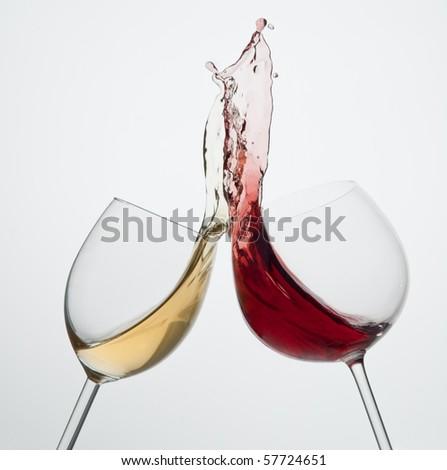 Toasting gesture red and white wine with big splash big splash - stock photo
