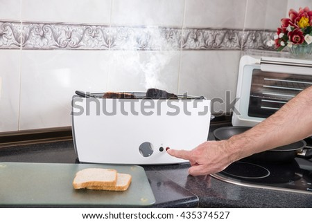 Toasting sandwich bread slices gone wrong - stock photo