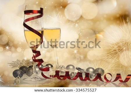 Toasting with champagne glasses on sparkling holiday background - stock photo