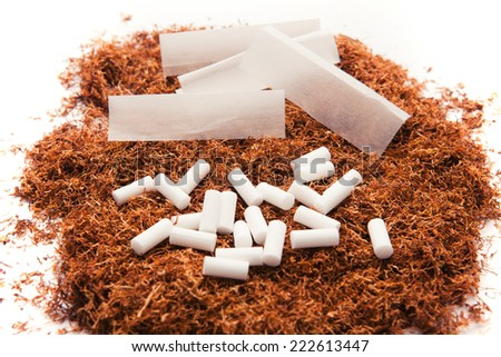 Tobacco, filters and smoking paper for rolling cigarettes. - stock photo