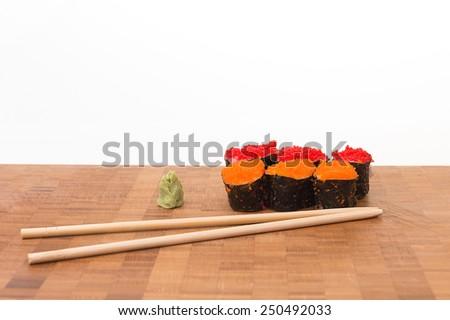 Tobiko Sushi set with wasabi and chopstick on White isolated background - stock photo