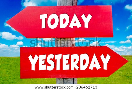 Today and yesterday concept on the red signs with landscape in background - stock photo