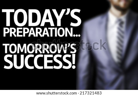 Today's Preparation...Tomorrow's Success written on a board with a business man on background - stock photo