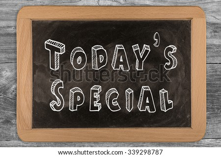 Today's special - chalkboard with outlined text - on wood - stock photo