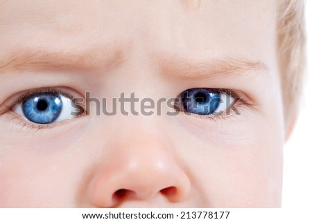 Toddler blond and blue eyes boy child with negative facial expressions isolated on white - stock photo