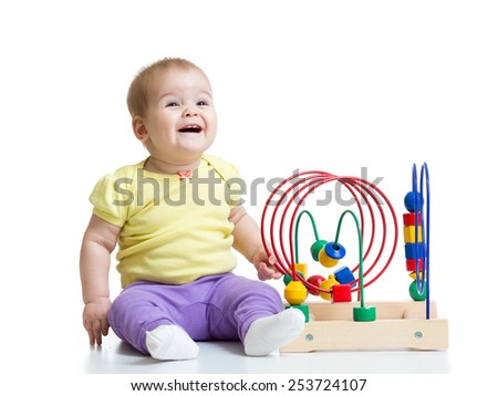 toddler girl playing with colorful toy isolated - stock photo