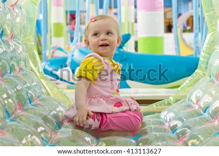 Toddler girl portrait sitting in the playroom - stock photo