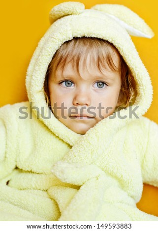 toddler girl wearing  bathrobe after bathing - stock photo