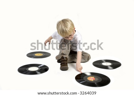 Toddler is playing with black vinyl - stock photo