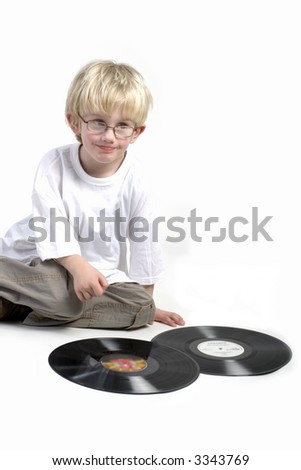toddler is surprised by black vinyl from yesterday - stock photo