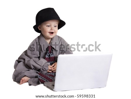 toddler playing on laptop - stock photo