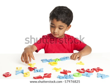 Toddler Playing with Alphabets - stock photo