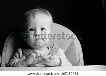 Toddler pondering an idea - stock photo