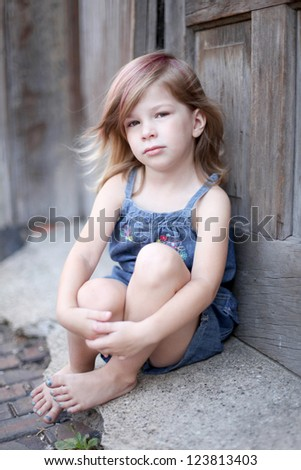 Toddler sitting in Alley - stock photo