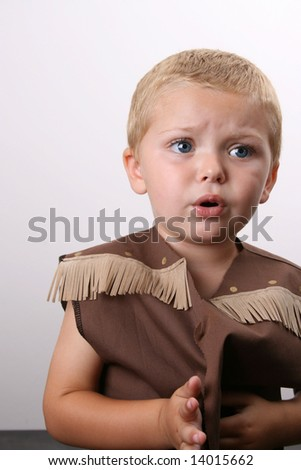 Toddler wearing a cowboy shirt with brown fringing - stock photo