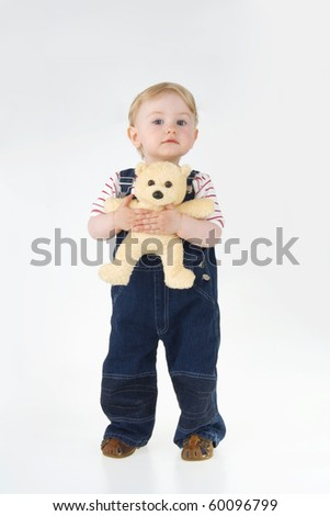 Toddler with his toy on white background. - stock photo