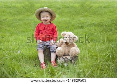 toddler with teddy bear - stock photo