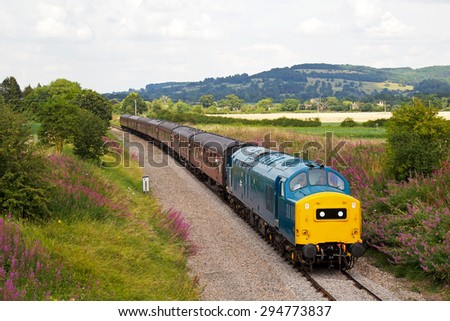 TODINGTON, UK - JULY 25: A preserved ex British Railways class 37 diesel locomotive takes passengers on pleasure trips during the GWSR summer diesel gala on July 25, 2014 in Todington - stock photo