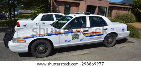 TOFINA BC CANADA JUNE 17 2015: Tofino RCMP police car.Royal Canadian Mounted Police known as the Mounties, and internally as 'the Force') is both a federal and a national police force of Canada.  - stock photo